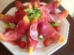 Melon bites wrapped in ham slices